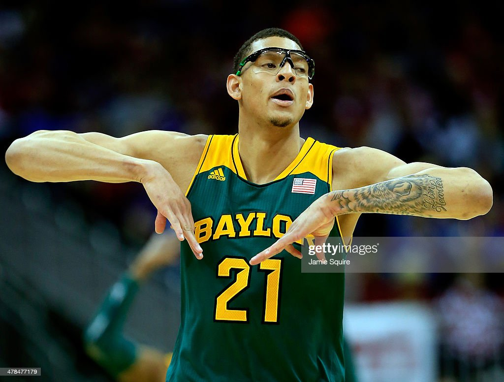 <a gi-track='captionPersonalityLinkClicked' href=/galleries/search?phrase=Isaiah+Austin&family=editorial&specificpeople=9082709 ng-click='$event.stopPropagation()'>Isaiah Austin</a> #21 of the Baylor Bears reacts after shooting a three-pointer during the Big 12 Basketball Tournament quarterfinal game against the Oklahoma Sooners at Sprint Center on March 13, 2014 in Kansas City, Missouri.