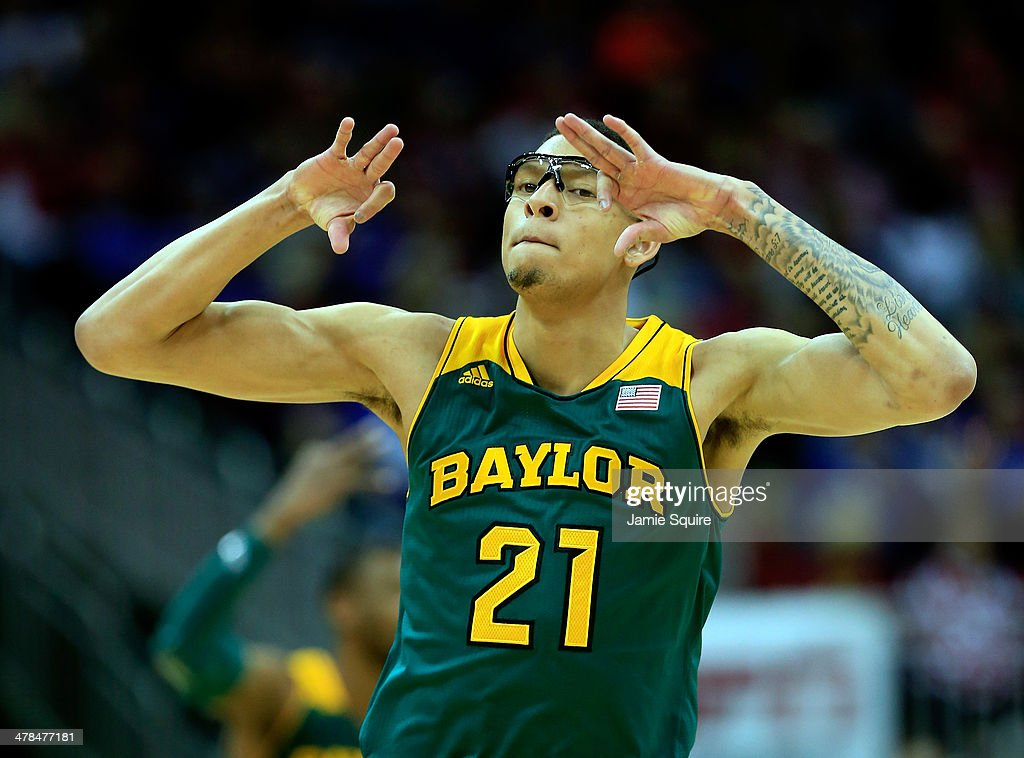 Isaiah Austin #21 of the Baylor Bears reacts after shooting a three-pointer during the Big 12 Basketball Tournament quarterfinal game against the Oklahoma Sooners at Sprint Center on March 13, 2014 in Kansas City, Missouri.
