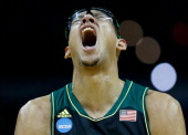 Isaiah Austin of the Baylor Bears reacts against the Creighton Bluejays during the third round of the 2014 NCAA Men's Basketball Tournament at the...