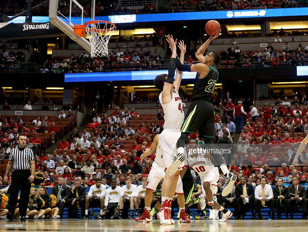 Isaiah Austin of the Baylor Bears shoots over Frank Kaminsky of the Wisconsin Badgers in the second half during the regional semifinal of the 2014...