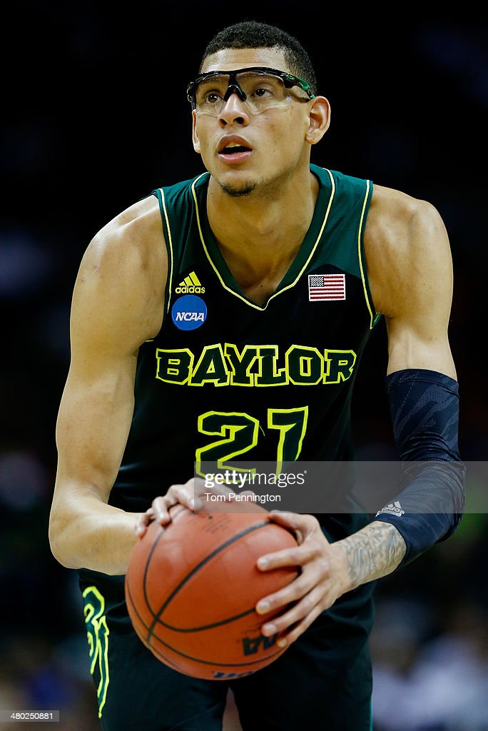 Isaiah Austin of the Baylor Bears takes a foul shot against the Creighton Bluejays during the third round of the 2014 NCAA Men's Basketball...