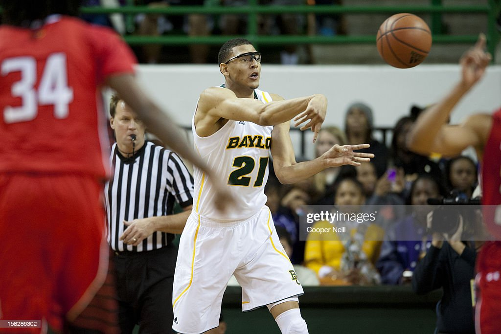 <a gi-track='captionPersonalityLinkClicked' href=/galleries/search?phrase=Isaiah+Austin&family=editorial&specificpeople=9082709 ng-click='$event.stopPropagation()'>Isaiah Austin</a> #21 of the Baylor University Bears passes the ball against the Lamar Cardinals on December 12, 2012 at the Ferrell Center in Waco, Texas.