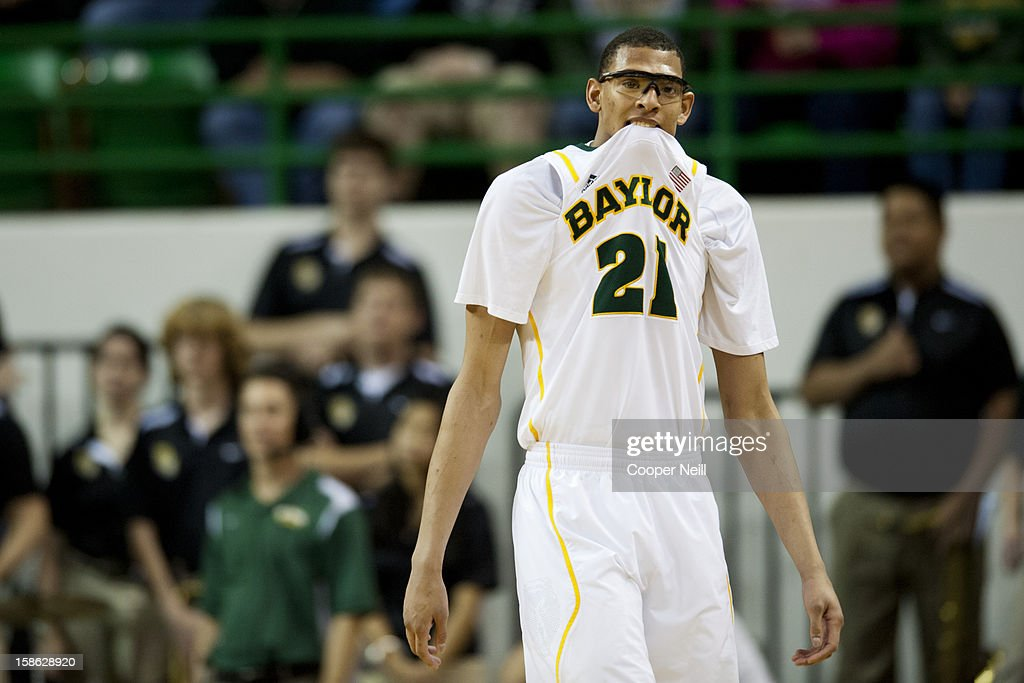 <a gi-track='captionPersonalityLinkClicked' href=/galleries/search?phrase=Isaiah+Austin&family=editorial&specificpeople=9082709 ng-click='$event.stopPropagation()'>Isaiah Austin</a> #21 of the Baylor University Bears reacts after a foul call against the Brigham Young University Cougars on December 21, 2012 at the Ferrell Center in Waco, Texas.
