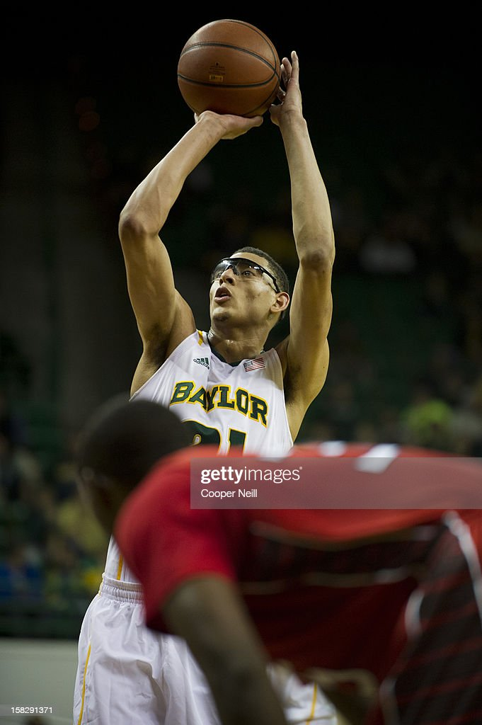 Isaiah Austin #21 of the Baylor University Bears shoots a free-throw against the Lamar Cardinals on December 12, 2012 at the Ferrell Center in Waco, Texas.