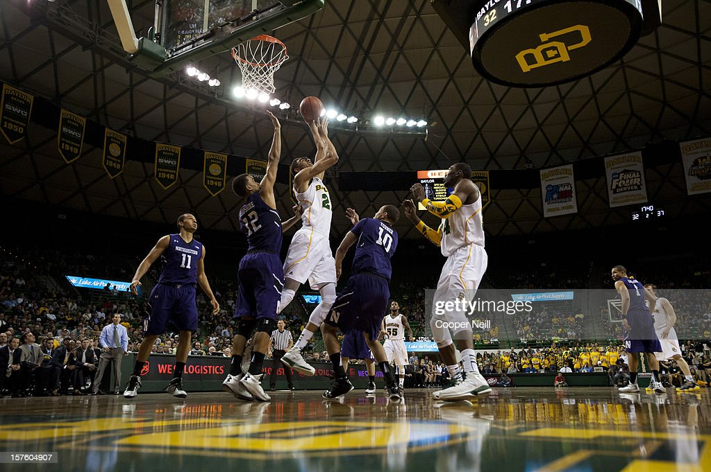<a gi-track='captionPersonalityLinkClicked' href=/galleries/search?phrase=Isaiah+Austin&family=editorial&specificpeople=9082709 ng-click='$event.stopPropagation()'>Isaiah Austin</a> #21 of the Baylor University Bears shoots the ball against the Northwestern University Wildcats on December 4, 2012 at the Ferrell Center in Waco, Texas.