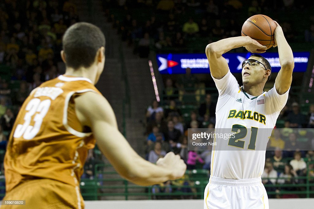 <a gi-track='captionPersonalityLinkClicked' href=/galleries/search?phrase=Isaiah+Austin&family=editorial&specificpeople=9082709 ng-click='$event.stopPropagation()'>Isaiah Austin</a> #21 of the Baylor University Bears shoots the ball against the University of Texas Longhorns on January 5, 2013 at the Ferrell Center in Waco, Texas.