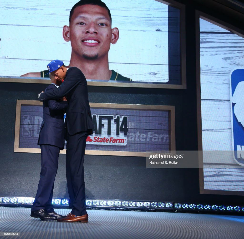 Isaiah Austin shakes hands with NBA Commissioner Adam Silver after being selected number overall by the during the 2014 NBA Draft on June 26 2014 at...
