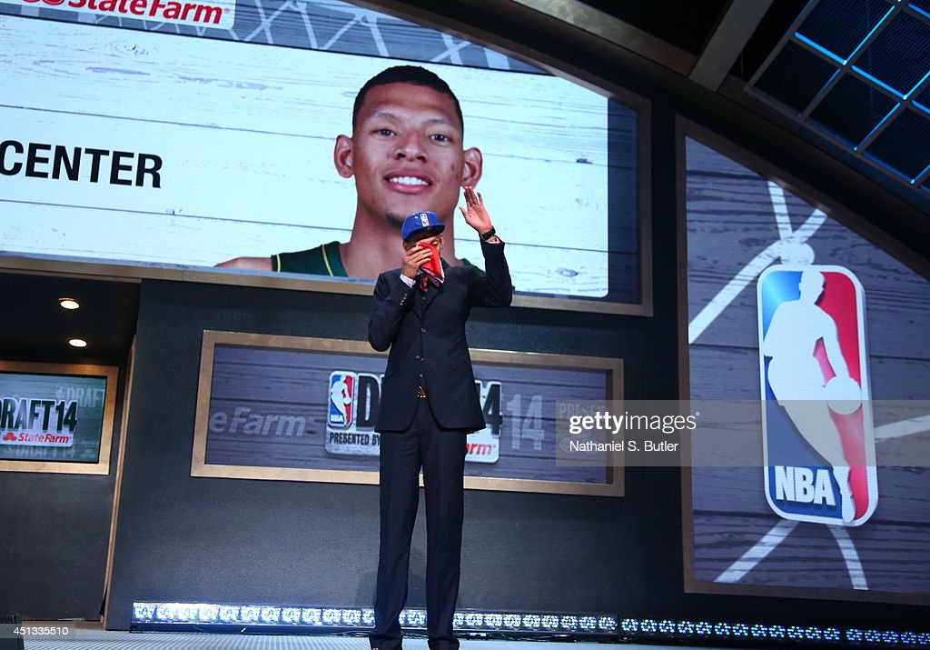Isaiah Austin waves to the crowd after being drafted by the NBA during the 2014 NBA Draft on June 26 2014 at Barclays Center in Brooklyn New York...