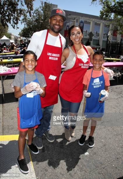 Isaiah Barnes NBA coach Derek Fisher Gloria Govan and Carter Barnes attend Los Angeles Mission's Easter Celebration at Los Angeles Mission on April...
