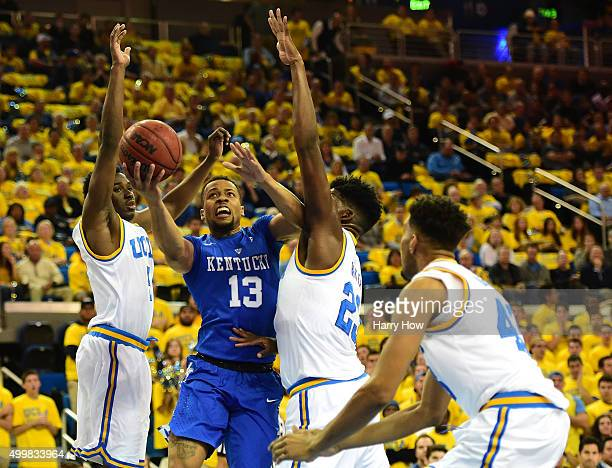 Isaiah Briscoe of the Kentucky Wildcats attempts a layup between Prince Ali Tony Parker and Jonah Bolden of the UCLA Bruins during th first half at...