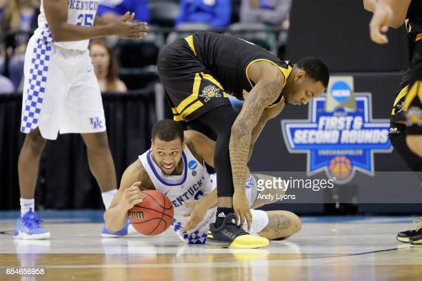 Isaiah Briscoe of the Kentucky Wildcats looks to pass the ball against Jeff Garrett of the Northern Kentucky Norse in the second half during the...