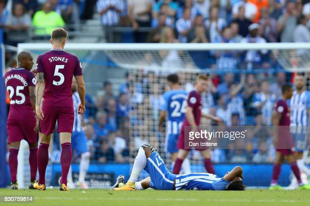 Isaiah Brown of Brighton and Hove Albion goes down injured during the Premier League match between Brighton and Hove Albion and Manchester City at...