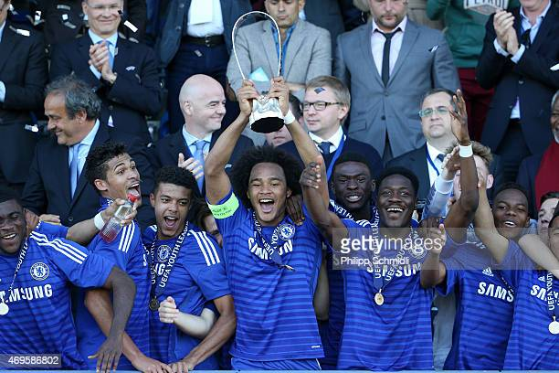 Isaiah Brown of Chelsea FC and his teammates celebrate with the Lennart Johansson trophy after the UEFA Youth League Final match between Shakhtar...