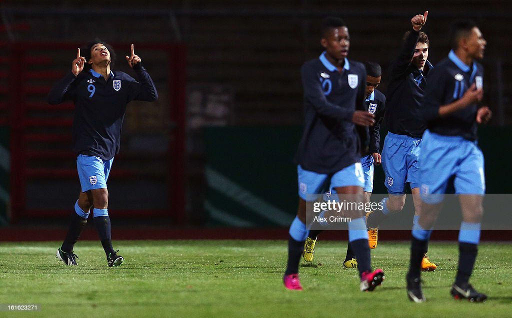 Isaiah Brown (L) of England celebrates his team's first goal during the U16 international friendly match between Germany and England at Suedstadion on February 13, 2013 in Cologne, Germany.
