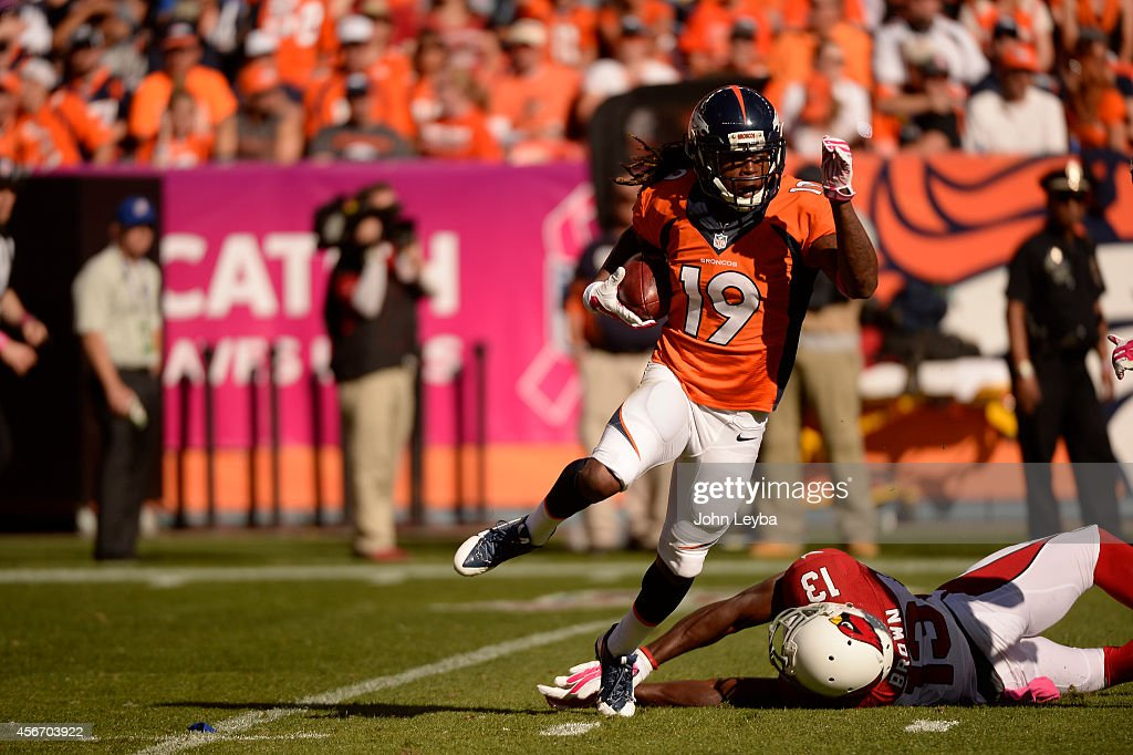 <a gi-track='captionPersonalityLinkClicked' href=/galleries/search?phrase=Isaiah+Burse&family=editorial&specificpeople=7228109 ng-click='$event.stopPropagation()'>Isaiah Burse</a> (19) of the Denver Broncos breaks a tackle on a punt return. The Denver Broncos played the Arizona Cardinals at Sports Authority Field at Mile High in Denver on October 5, 2014.