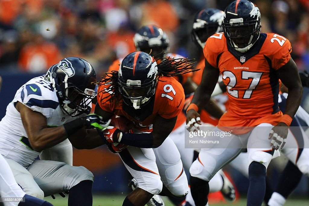 <a gi-track='captionPersonalityLinkClicked' href=/galleries/search?phrase=Isaiah+Burse&family=editorial&specificpeople=7228109 ng-click='$event.stopPropagation()'>Isaiah Burse</a> (19) of the Denver Broncos carries the ball against the Seattle Seahawks during a preseason game at Sports Authority Field at Mile High on Thursday, August 07, 2014 in Denver, Colorado.