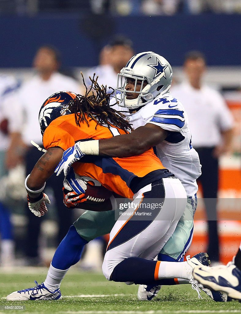 <a gi-track='captionPersonalityLinkClicked' href=/galleries/search?phrase=Isaiah+Burse&family=editorial&specificpeople=7228109 ng-click='$event.stopPropagation()'>Isaiah Burse</a> #19 of the Denver Broncos is tackled by <a gi-track='captionPersonalityLinkClicked' href=/galleries/search?phrase=Jemea+Thomas&family=editorial&specificpeople=8312198 ng-click='$event.stopPropagation()'>Jemea Thomas</a> #47 of the Dallas Cowboys in the second half of their preseason game at AT&T Stadium on August 28, 2014 in Arlington, Texas.