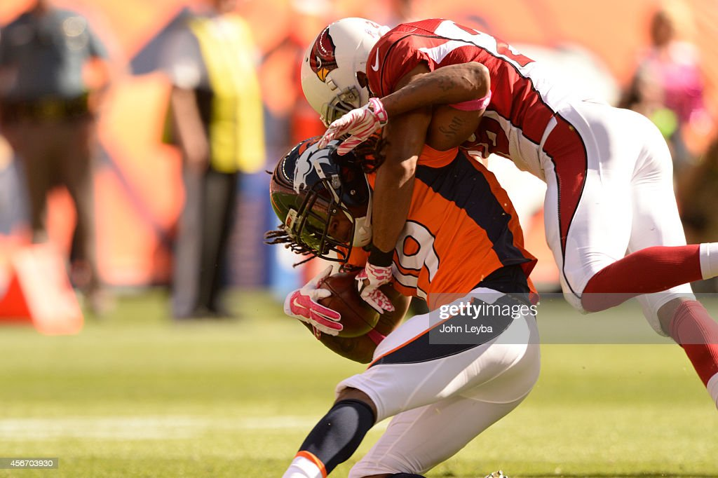 <a gi-track='captionPersonalityLinkClicked' href=/galleries/search?phrase=Isaiah+Burse&family=editorial&specificpeople=7228109 ng-click='$event.stopPropagation()'>Isaiah Burse</a> (19) of the Denver Broncos is tackled on a punt return. The Denver Broncos played the Arizona Cardinals at Sports Authority Field at Mile High in Denver on October 5, 2014.
