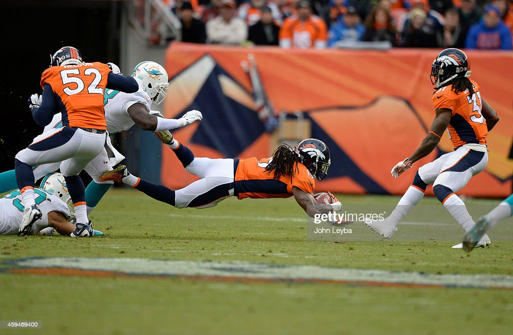<a gi-track='captionPersonalityLinkClicked' href=/galleries/search?phrase=Isaiah+Burse&family=editorial&specificpeople=7228109 ng-click='$event.stopPropagation()'>Isaiah Burse</a> (19) of the Denver Broncos returns a punt in the first quarter. The Denver Broncos played the Miami Dolphins at Sports Authority Field at Mile High in Denver on November 23, 2014.
