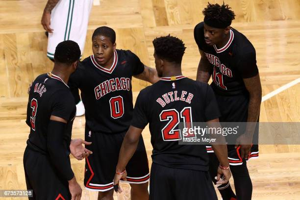 Isaiah Canaan Jimmy Butler Dwyane Wade and Anthony Morrow of the Chicago Bulls huddle during the second quarter of Game Five of the Eastern...