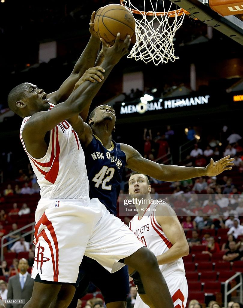Isaiah Canaan #1 of the Houston Rockets is fouled by Lance Thomas #42 of the New Orleans Pelicans in a preseason NBA game on October 5, 2013 at Toyota Center in Houston, Texas. The Pelicans won 116 to 115.