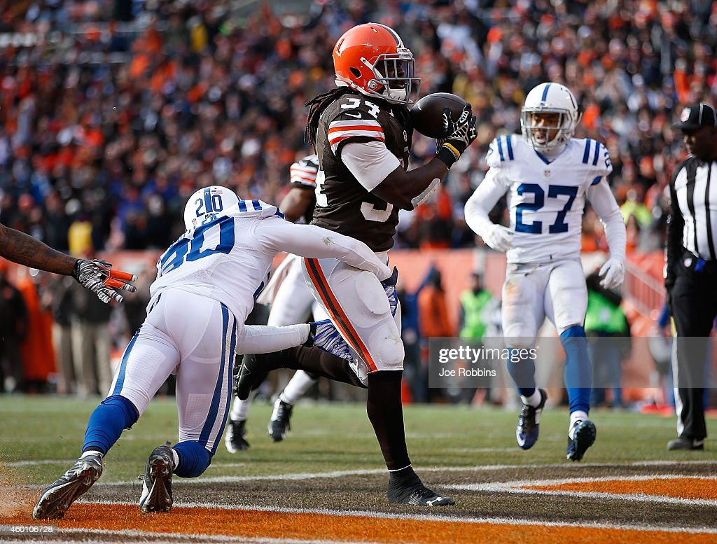 <a gi-track='captionPersonalityLinkClicked' href=/galleries/search?phrase=Isaiah+Crowell&family=editorial&specificpeople=8176797 ng-click='$event.stopPropagation()'>Isaiah Crowell</a> #34 of the Cleveland Browns scores a touchdown in front of <a gi-track='captionPersonalityLinkClicked' href=/galleries/search?phrase=Darius+Butler&family=editorial&specificpeople=3967703 ng-click='$event.stopPropagation()'>Darius Butler</a> #20 of the Indianapolis Colts during the second quarter at FirstEnergy Stadium on December 7, 2014 in Cleveland, Ohio.