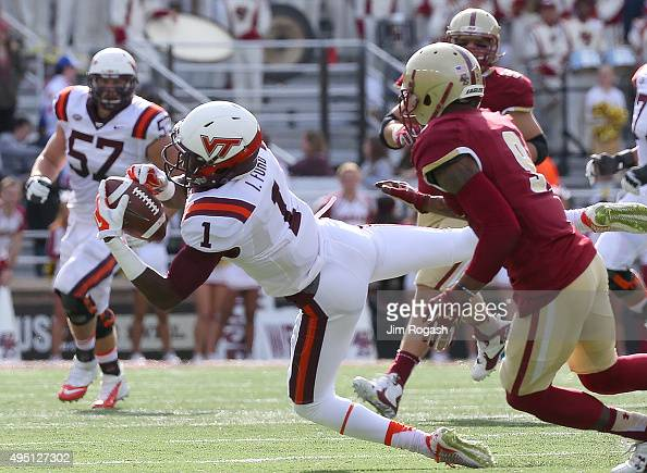 Isaiah Ford of the Virginia Tech Hokie makes a catch as John Johnson of the Boston College Eagles defends in the first half at Alumni Stadium on...