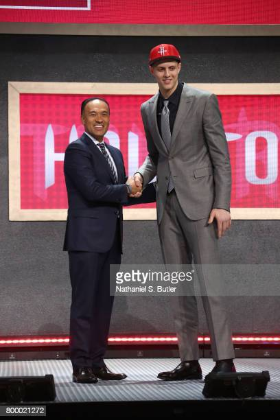Isaiah Hartenstein shakes hands with Deputy Commissioner Mark Tatum after being selected number overall by the Houston Rockets during the 2017 NBA...
