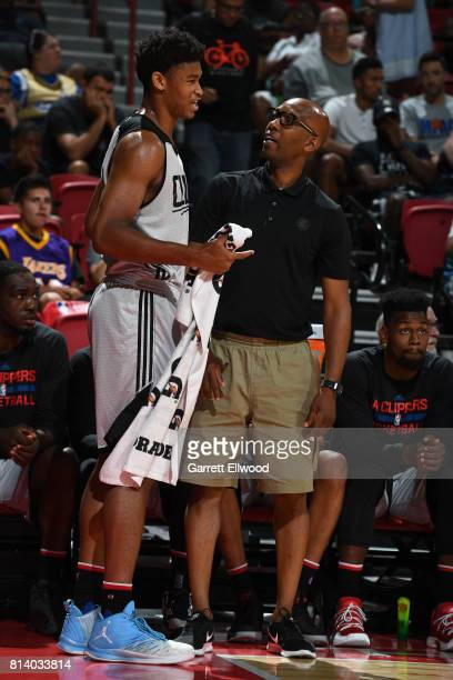 Isaiah Hicks and Head Coach Sam Cassell of the LA Clippers talk during the game against the Miami Heat on July 13 2017 at the Thomas Mack Center in...