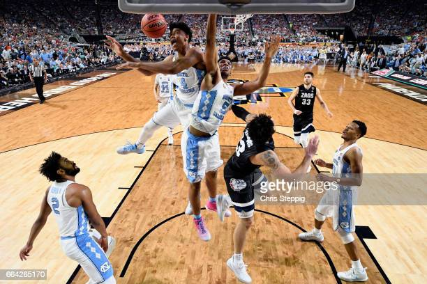 Isaiah Hicks and Tony Bradley look for a rebound during the 2017 NCAA Men's Final Four National Championship game against the Gonzaga Bulldogs at...