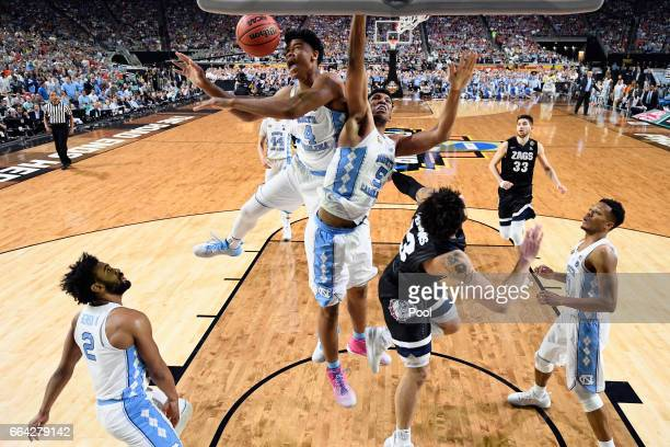 Isaiah Hicks and Tony Bradley of the North Carolina Tar Heels compete for the ball against Josh Perkins of the Gonzaga Bulldogs during the 2017 NCAA...