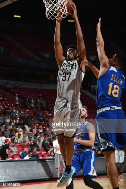Isaiah Hicks of the LA Clippers goes to the basket against the Golden State Warriors on July 14 2017 at the Thomas Mack Center in Las Vegas Nevada...