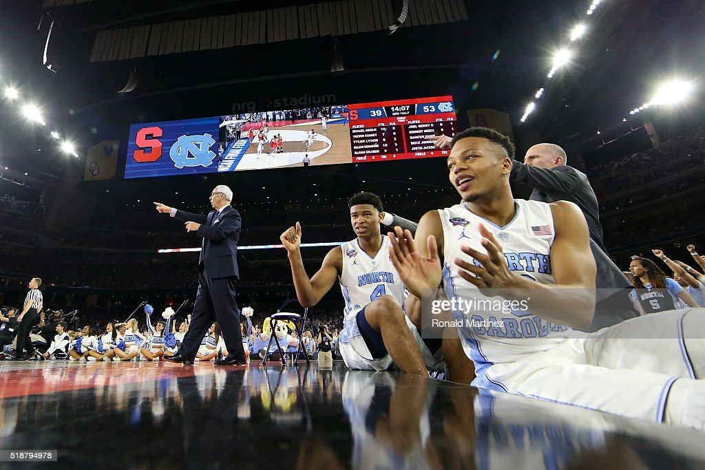 Isaiah Hicks of the North Carolina Tar Heels and Nate Britt react in the second half against the Syracuse Orange during the NCAA Men's Final Four...