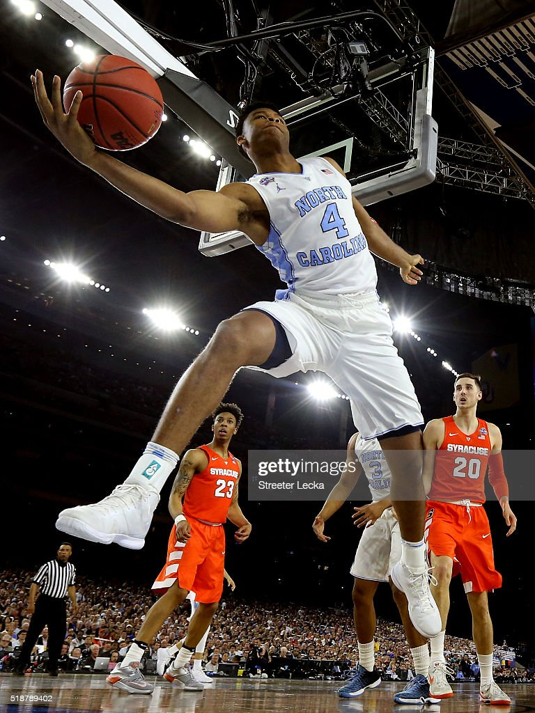Isaiah Hicks of the North Carolina Tar Heels attempts to prevent the ball from going out of bounds in the first half against the Syracuse Orange...