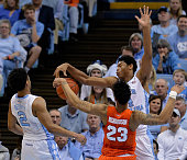 Isaiah Hicks of the North Carolina Tar Heels blocks a shot by Malachi Richardson of the Syracuse Orange during a game at the Dean Smith Center on...