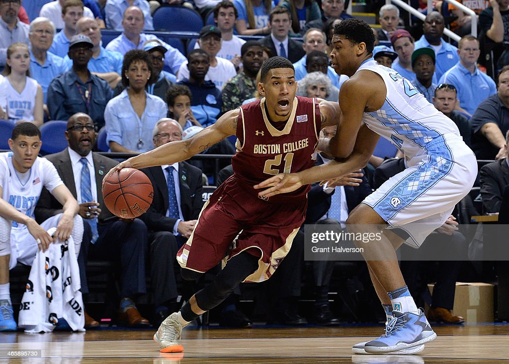 Isaiah Hicks #22 of the North Carolina Tar Heels defends <a gi-track='captionPersonalityLinkClicked' href=/galleries/search?phrase=Olivier+Hanlan&family=editorial&specificpeople=10135196 ng-click='$event.stopPropagation()'>Olivier Hanlan</a> #21 of the Boston College Eagles during a second round game of the ACC basketball tournament at Greensboro Coliseum on March 11, 2015 in Greensboro, North Carolina.