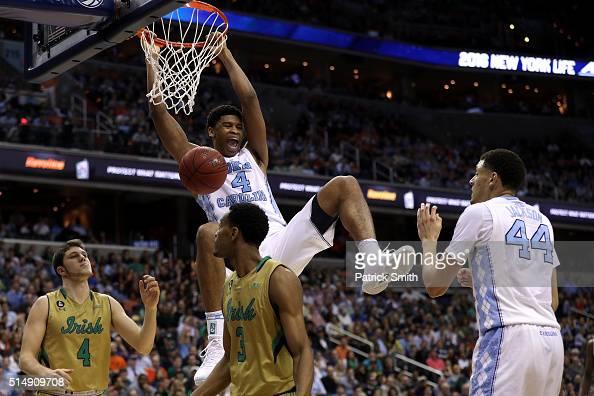Isaiah Hicks of the North Carolina Tar Heels dunks in front of Matt Ryan and VJ Beachem of the Notre Dame Fighting Irish during the second half in...