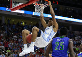 Isaiah Hicks of the North Carolina Tar Heels dunks the ball in the second half against the Florida Gulf Coast Eagles during the first round of the...