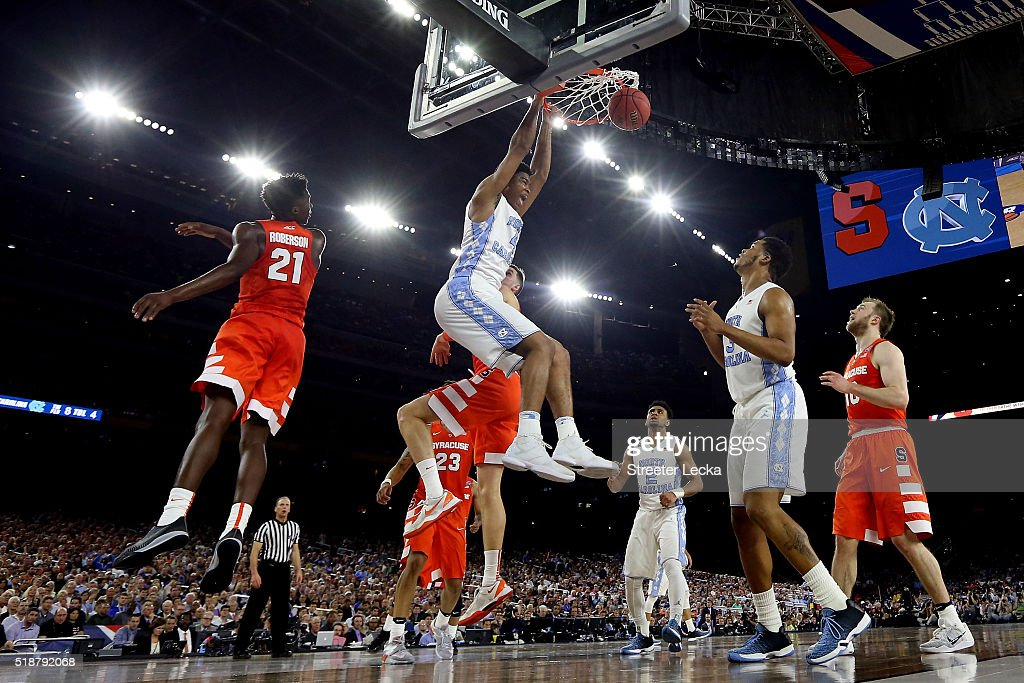 Isaiah Hicks of the North Carolina Tar Heels dunks the ball in the first half against the Syracuse Orange during the NCAA Men's Final Four Semifinal...
