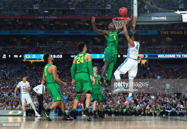 Isaiah Hicks of the North Carolina Tar Heels goes up with the ball against Jordan Bell of the Oregon Ducks in the first half during the 2017 NCAA...
