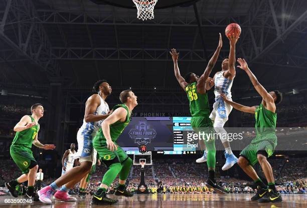 Isaiah Hicks of the North Carolina Tar Heels shoots against Kavell BigbyWilliams of the Oregon Ducks in the second half during the 2017 NCAA Men's...
