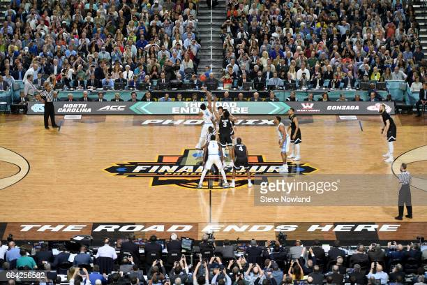 Isaiah Hicks of the North Carolina Tar Heels tipsoff against Johnathan Williams of the Gonzaga Bulldogs during the 2017 NCAA Men's Final Four...