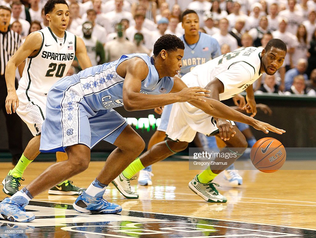 Isaiah Hicks #22 of the North Carolina Tar Heels tries to control the ball next to Branden Dawson #22 of the Michigan State Spartans during the first half at the Jack T. Breslin Student Events Center on December 4, 2013 in East Lansing, Michigan.