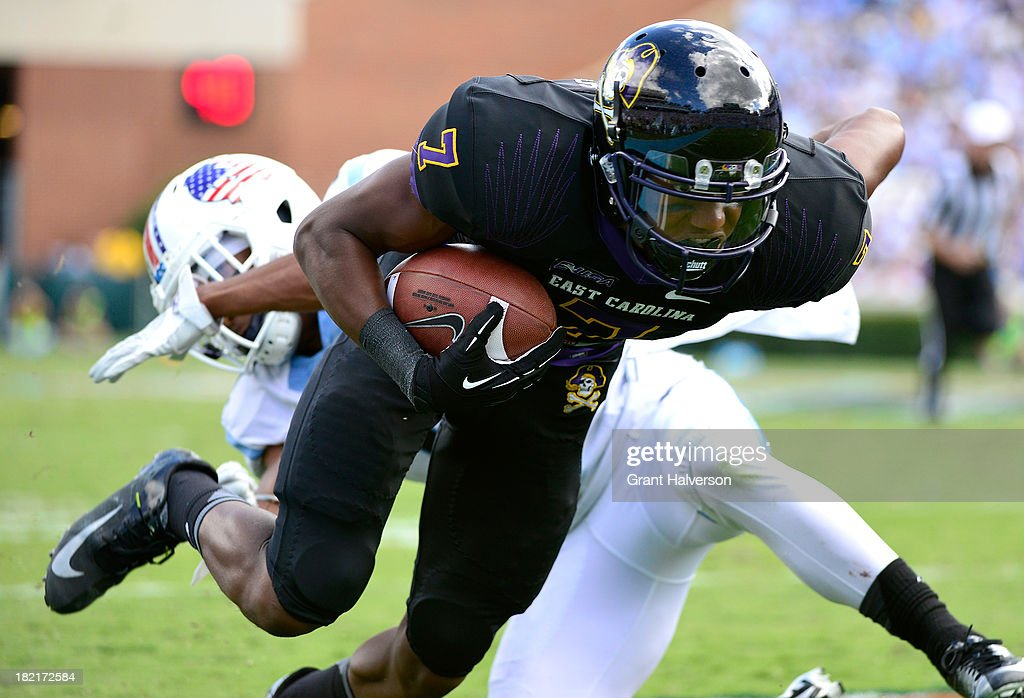 Isaiah Jones #7 of the East Carolina Pirates fights for extra yardage against the North Carolina Tar Heels at Kenan Stadium on September 28, 2013 in Chapel Hill, North Carolina. East Carolina won 55-31.