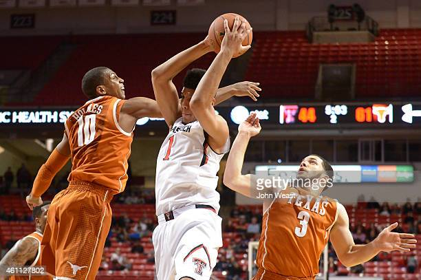 Isaiah Manderson of the Texas Tech Red Raiders grabs the rebound Jonathan Holmes and Javan Felix of the Texas Longhorns during a game on January 3...