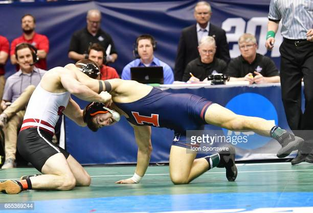 Isaiah Martinez of Illinois attempts a takedown of Isaac Jordan of Wisconsin in a semifinal match of the 165pound weight class of the NCAA Wrestling...