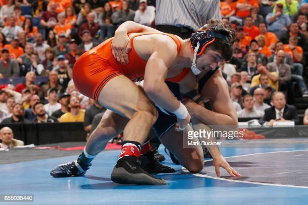 Isaiah Martinez of Illinois wrestles Vincenzo Joseph of Penn State in the 165lb Championship match during the Division 1 Men's Wrestling...