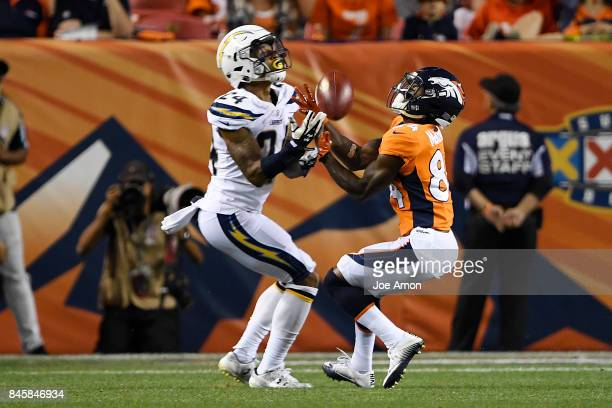 Isaiah McKenzie of the Denver Broncos grabs a punt away from Trevor Williams of the Los Angeles Chargers during the second quarter on Monday...