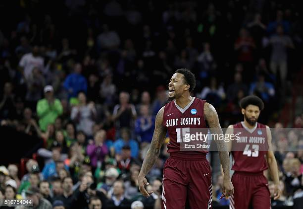 Isaiah Miles of the Saint Joseph's Hawks reacts alongside teammate DeAndre Bembry in the second half against the Oregon Ducks during the second round...