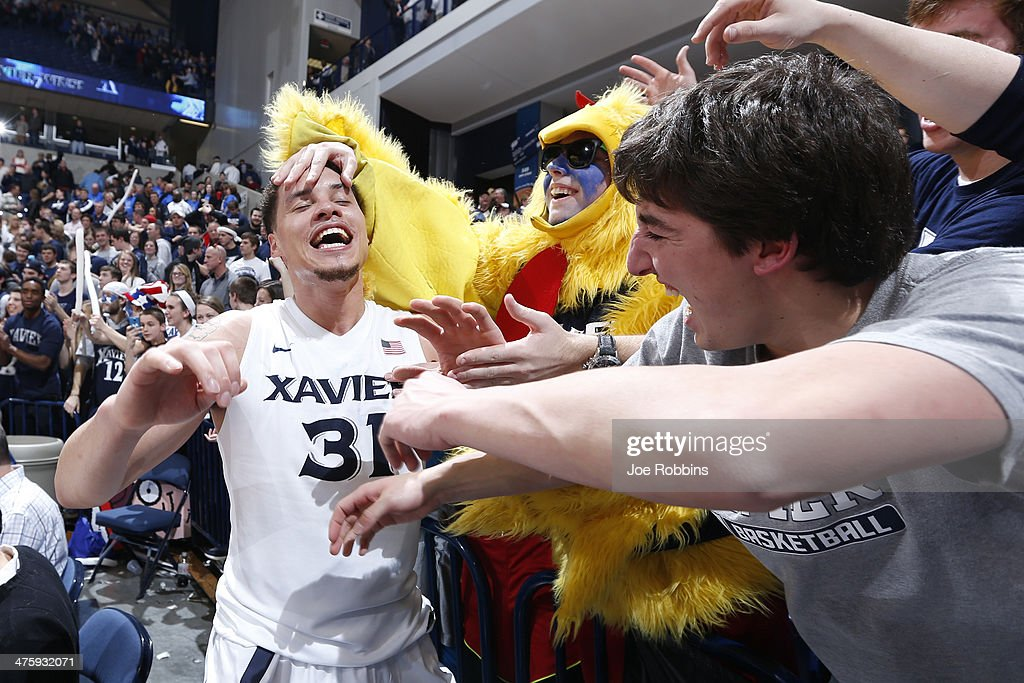 Isaiah Philmore of the Xavier Musketeers celebrates with fans after the game against the Creighton Bluejays at Cintas Center on March 1 2014 in...